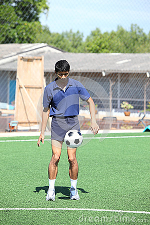 Soccer player juggle the ball  with his feet