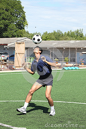 Soccer player juggle the ball  with his head