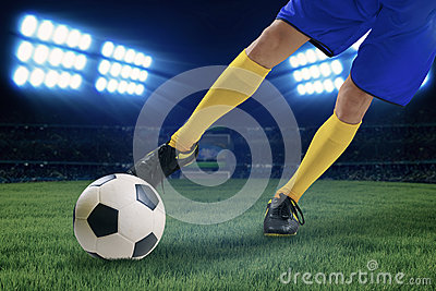 Soccer player kicking the ball 1