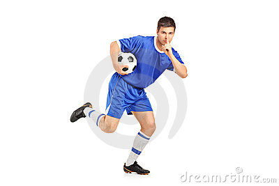 A soccer player running and gesturing silence