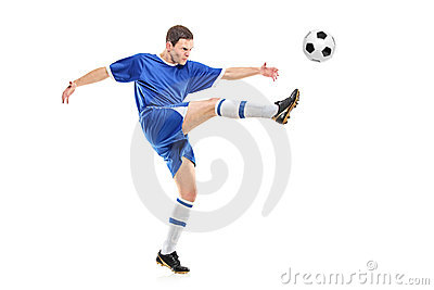 A soccer player shooting a ball