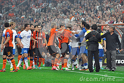 Soccer players fighting on the pitch Editorial Stock Photo