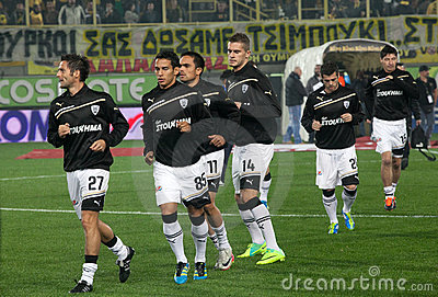The soccer players Paok gets into the playing area Editorial Photography