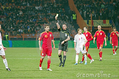 Soccer referee with yellow card Editorial Image