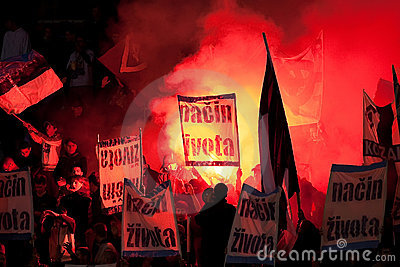Soccer supporters with alight torches Editorial Stock Image
