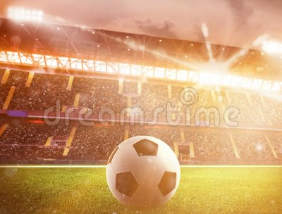 Soccerball at the stadium during sunset. Soccerball on the lawn of a stadium during sunset stock video