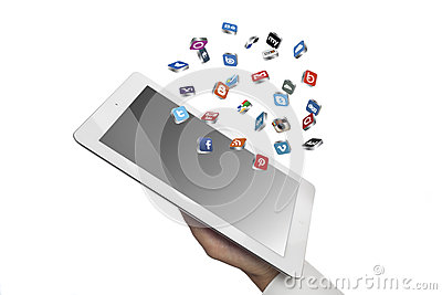 Social media icons fly off the ipad in hand Editorial Image