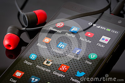 Social media icons on smart phone screen Editorial Photography