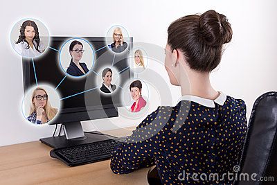 Social network concept - beautiful business woman using pc with