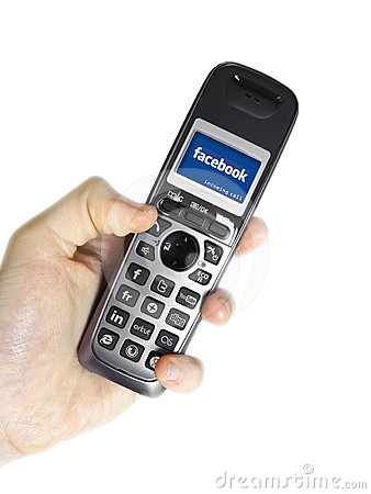 Social networking cordless phone loading Facebook Editorial Photography