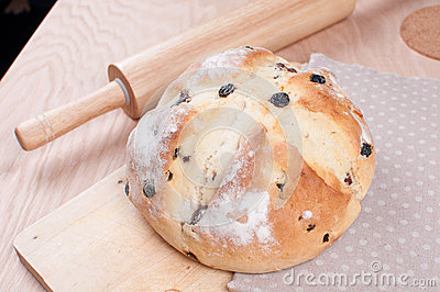 Soda bread with rolling pan on the table