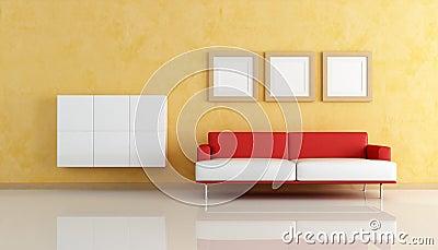Sof rojo y blanco en una sala de estar anaranjada for Sala de estar rojo y blanco