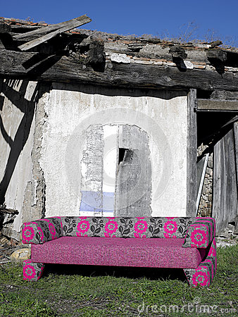 Sofa in abandoned rural place
