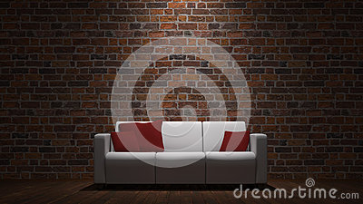 Sofa in front of brick wall