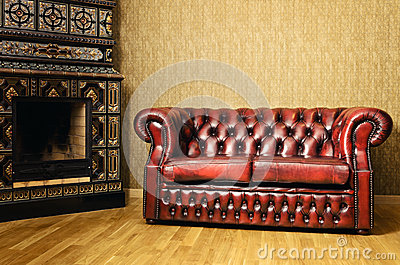Sofa Near The Fireplace