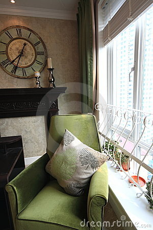 Sofa with pillow by the window