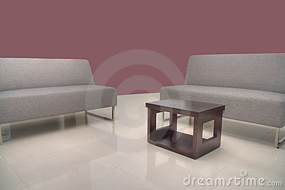 Sofas with coffee table with Maroon Wall