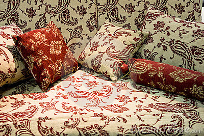 Soft beige sofa with red pillows