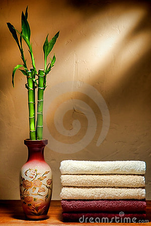 Soft Cotton Towels and Bamboo Asian Vase in a Spa