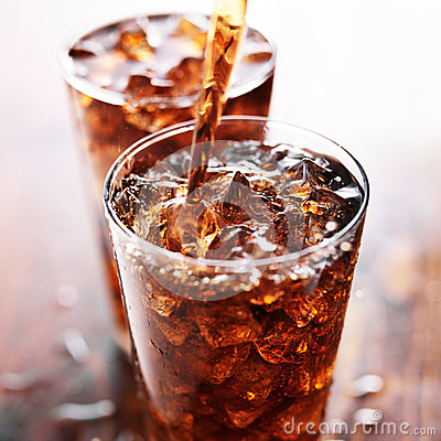 Free Soft Drink Being Poured Into Glass Stock Photo - 50315340