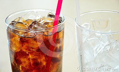 Soft drinks and ice in clear glass
