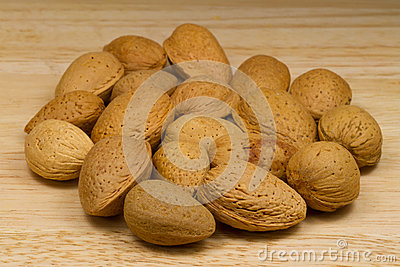 Soft-shelled Almonds on beige background