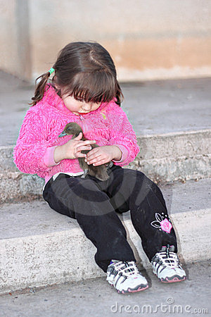 Softness - Girl Holding Baby Duck