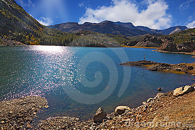 Solar midday. Sparkling azure lake