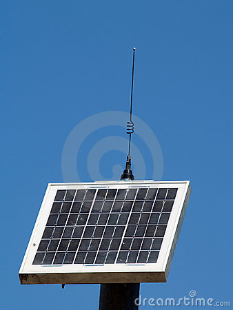 Solar panel with antennae against blue sky