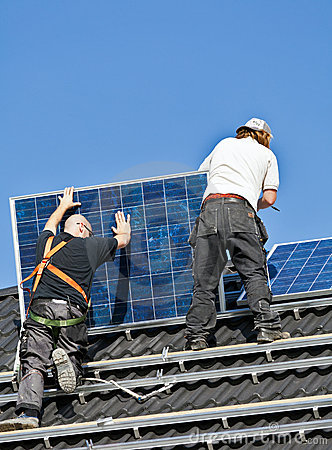 Solar panels being mounted on roof Editorial Stock Image