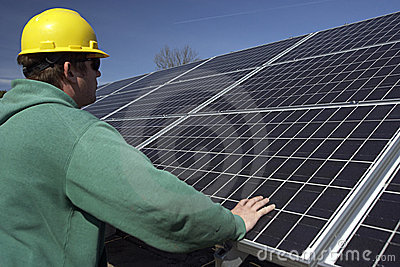 Solar panels inspected by workman