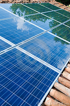 Free Solar Panels On Roof With Green Reflection Royalty Free Stock Image - 10189566
