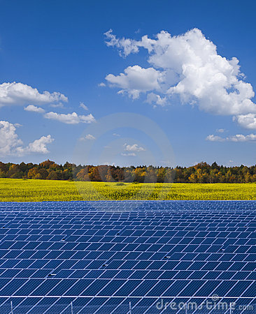 Free Solar Power Plant And Rapesed Field In Germany Royalty Free Stock Images - 22057979