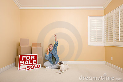 Sold Real Estate Signs, Boxes and Woman on Phone
