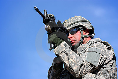 A soldier aiming