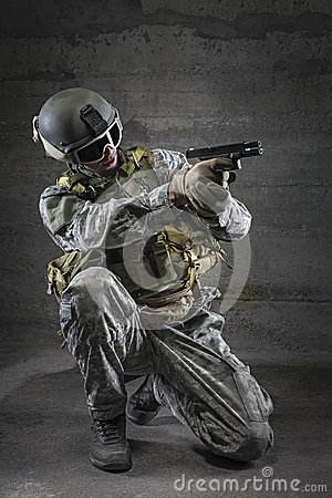 Soldier aiming a pistol