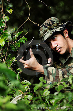 Soldier aims at his target