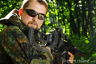 The Soldier With Automatic Rifle Stock Image - Image: 23399541
