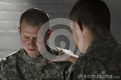Soldier consoles peer with PTSD, horizontal