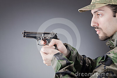 Soldier with gun in studio