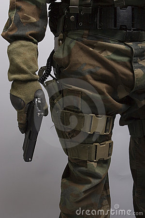 Free Soldier Holding A Pistol Royalty Free Stock Photography - 1032077