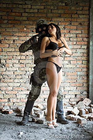 Soldier holding woman