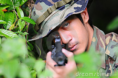 Soldier looking through the iron sights