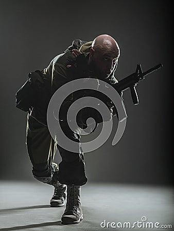 Free Soldier Man Hold Machine Gun On A  Dark Background Royalty Free Stock Photos - 71057218