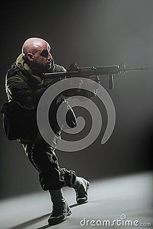Free Soldier Man Hold Machine Gun On A  Dark Background Stock Photography - 71057282
