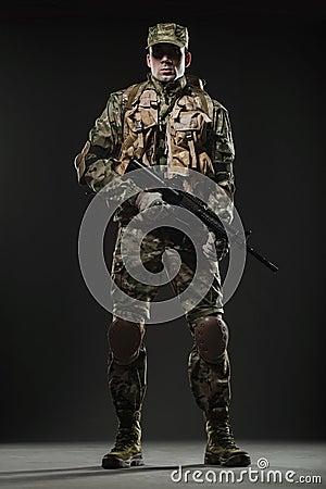 Free Soldier Man Hold Machine Gun On A  Dark Background Royalty Free Stock Image - 71058016