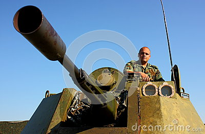 Soldier on military armored vehicle