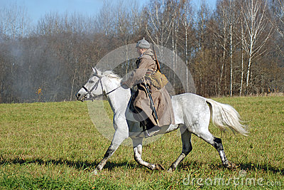 A soldier-reenactor rides a white horse Editorial Photography