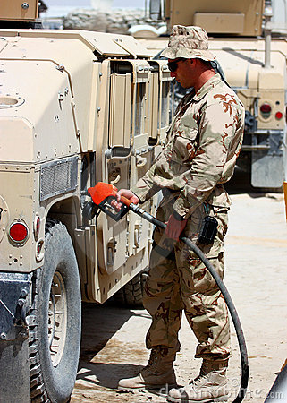 A soldier refueling a vehicle