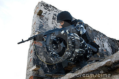 Soldier with a rifle in position
